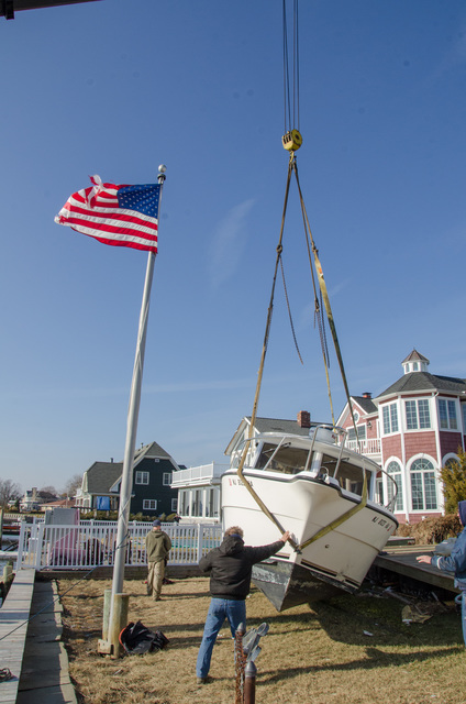 Rumson, N.J., Nov. 26, 2012 -- This boat was dropped in a back yard during Hurricane Sandy by the storm surge. FEMA is working with state and local officials to assist residents who were affected by Hurricane Sandy. Photo by Liz Roll/FEMA