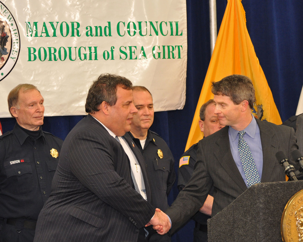 Sea Girt, N.J., Feb. 6, 2013 -- Governor Chris Christie (L), shakes hands with Mayor Ken Farrell (R), of Sea Girt prior to his introduction at the National Guard Training Center in Sea Girt.  Governor Christie focused on beachfront reconstruction as well as entertaining questions from the press.  Photo by Sharon Karr/FEMA