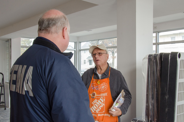 Seaside Heights, N.J., Feb. 26, 2011 -- FEMA employee Art Goetz talks with Home Depot employee Pat Grosso at a new satellite store in Seaside Heights. The store will open in the coming weeks and will serve the community's rebuilding needs as they recover from Hurricane Sandy. Photo by Liz Roll/FEMA