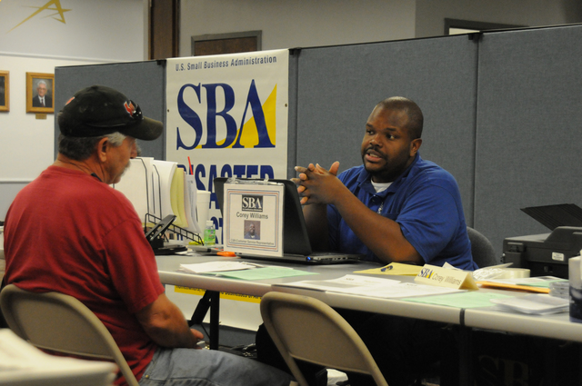 Shawnee, Okla., June 17, 2013 -- FEMA/State Disaster Recovery Center (DRC) #3 is open and Small Business Administration (SBA) Customer Services Representative Corey Williams speaks with a May 19-20 tornado survivor who is applying for disaster recovery assistance. SBA has low interest loans and other programs to help eligible applicants.  George Armstrong/FEMA