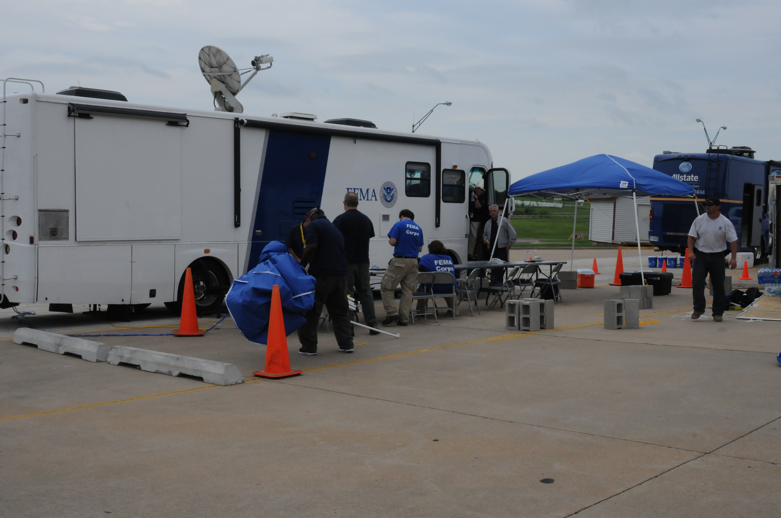 Shawnee, Okla., May 28, 2013 -- FEMA Corps Disaster Survivors Assistance Team (DSAT) members are helping to set up this Mobile Intake Registration Center (MIRC) vehicle at the Gordon Cooper Technology Center. FEMA is here in response to the tornadoes of May 19-20.  George Armstrong/FEMA