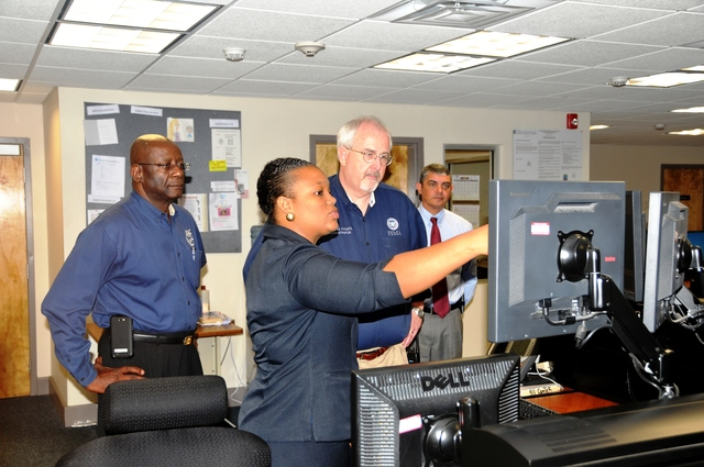 St. Thomas, US Virgin Islands, April 12, 2013 -- Carolyn Wattley, 911 St.Thomas-St. John District Manager, gives FEMA Administrator Fugate a demonstration of the Computer-Aided Dispatch system