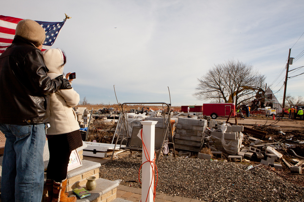 Staten Island, N.Y., Dec. 20, 2012 -- Homeowner Leillanie Morrissey photographs the remains of her home which was destroyed by Hurricane Sandy. The home will be removed because it is blocking street access. FEMA's Public Assistance Program allows for debris removal from public property to eliminate health and safety hazards. Andrea Booher/FEMA
