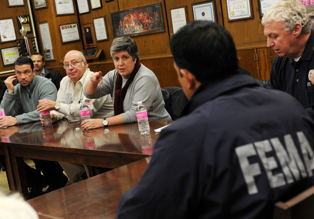 Staten Island, N.Y., Nov. 2, 2012 -- Department of Homeland Security Secretary Janet Napolitano, center, gets a briefing from local officials and FEMA officials at a shelter at Susan Wagner high school.  The shelter is set up to assist residents impacted by Hurricane Sandy.Jocelyn Augustino/FEMA