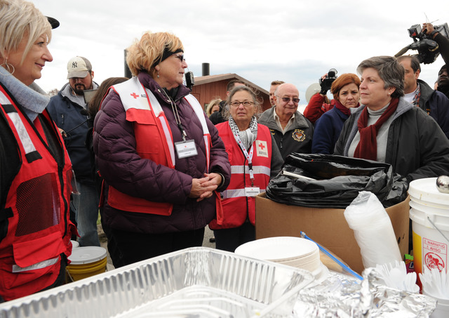 Staten Island, N.Y., Nov. 2, 2012 -- Department of Homeland Security Secretary Janet Napolitano, right, talks to  Red Cross volunteers at a distribution point at Miller's Field.  Other volunteer agencies are set up with relief supplies to assist residents impacted by Hurricane Sandy.  Jocelyn Augustino/FEMA