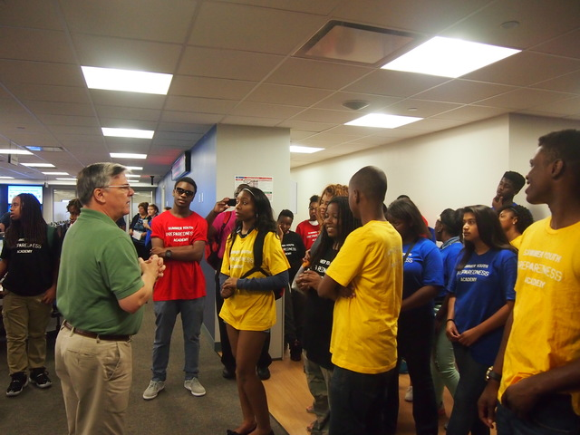 Thirty young students from the SERVE DC Summer Youth Emergency Preparedness and Community Resilience Academy tour the National Response Coordination Center led by NRCC Manager Steve Burgess