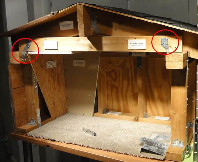 This model house shows some aspects of earthquake retrofitting look like. The circle on the right shows a ceiling joist, while the left-hand circle shows another joist that can keep a home from being displaced from its concrete foundation during an earthquake