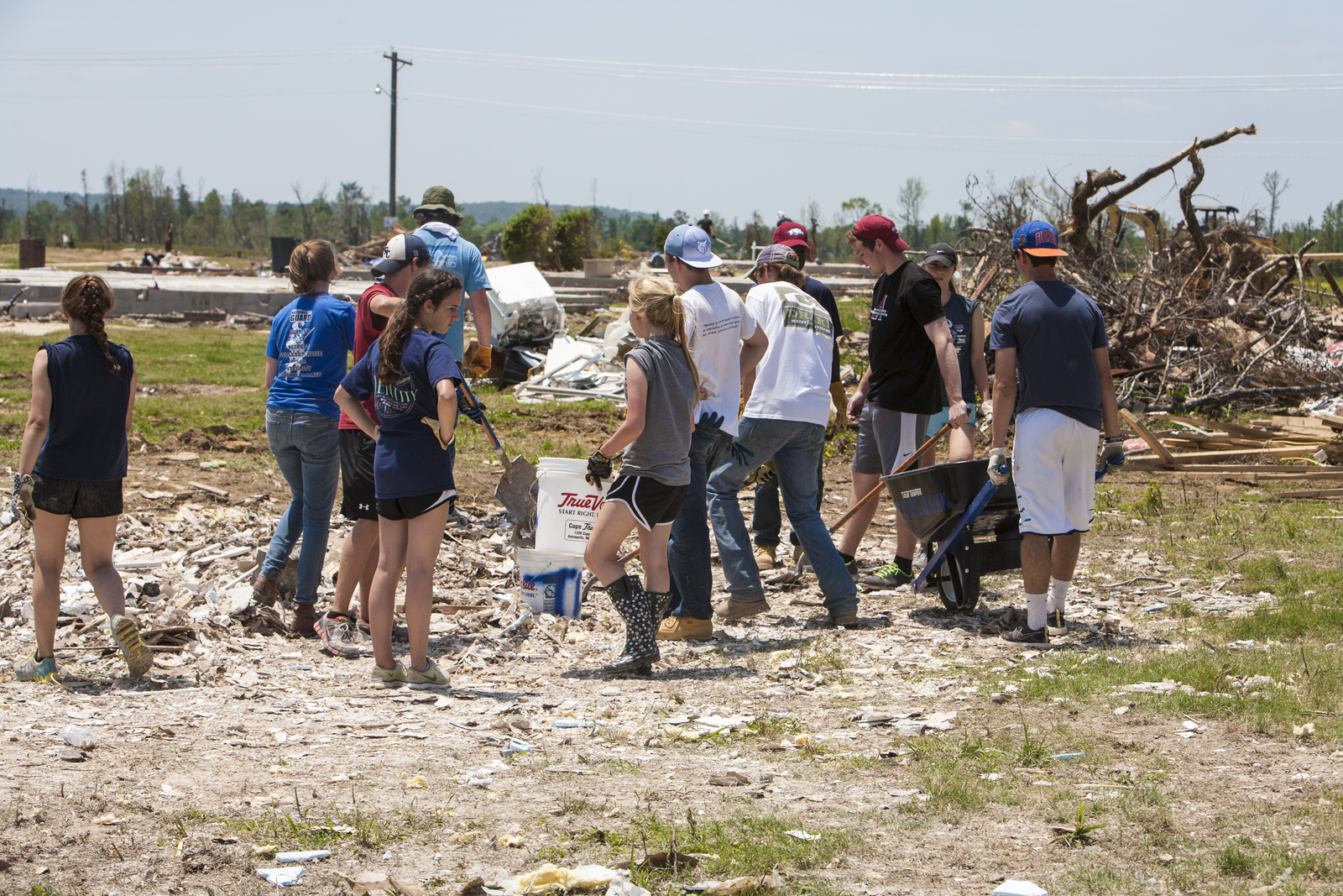 Vilonia, AR, May 21, 2014 – Team Rubicon volunteers remove debris from a home and property in Parkwood Meadows near Naylor Road after the home was destroyed by a tornado on April 27. FEMA supports Voluntary Organizations Active in Disaster (VOAD) as they help survivors recover from natural disasters. Photo by Christopher Mardorf / FEMA