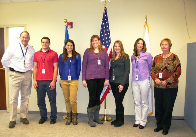 Warwick, R.I., Jan. 7, 2013 -- James N. Russo, left, federal coordinating officer in charge of FEMA's Hurricane Sandy response and recovery program in Rhode Island, swore in six new employees from The Ocean State on January 7, 2013. From left, they are, Augusto Faria, Hillary Slocum, Carissa Lord, Lacey Laflamme, Kim DiCecco and Nancy Howland. A seventh new local hire, Mike Campilio, was not present for the swearing in ceremony. Four of the new members of the FEMA workforce are in public assistance, two in mitigation and one in logistics. Photo by Nancy Helmick