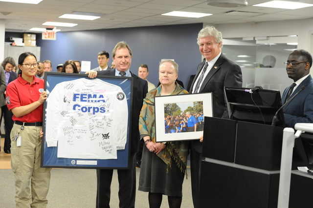 Washington, D.C., January 23, 2014 -- Deputy Administrator Serino is thanked for his dedication and commitment to service by representatives from Joe Burchette and Kate Raftery of the Corporation for National and Community Service (CNCS) and FEMA Corps Member Harmony Chai. After serving over four years as Deputy Administrator of FEMA, Serino is retiring and returning to Boston, Mass. with his family