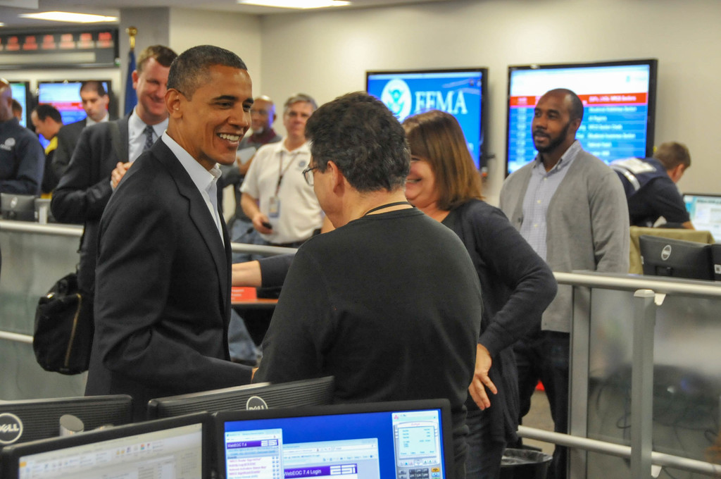 Washington, D.C., Oct. 28, 2012 -- President Barack Obama greets employees while touring FEMA's National Response Coordination Center following a briefing with federal agency partners on preparations for Hurricane Sandy.  FEMA/Aaron Skolnik