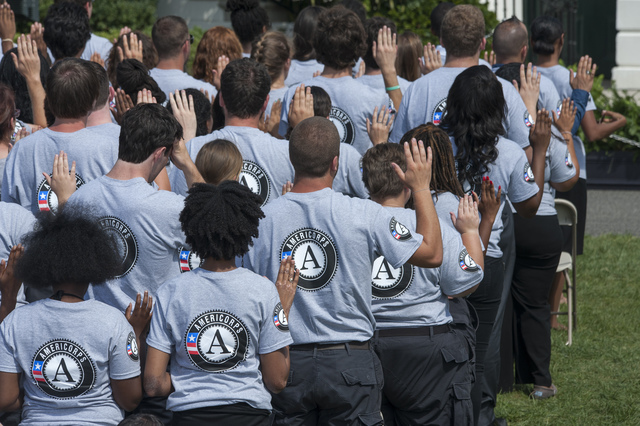 Washington, D.C., September 12, 2014 -- Members of 2014 class of AmeiCorps take their pledge for service on the South Lawn of the White House. President Obama is joined by former President Bill Clinton as they celebrate the 20th Anniversary of AmeriCorps Pledge on the south lawn of the White House. Photo by Patsy Lynch/FEMA