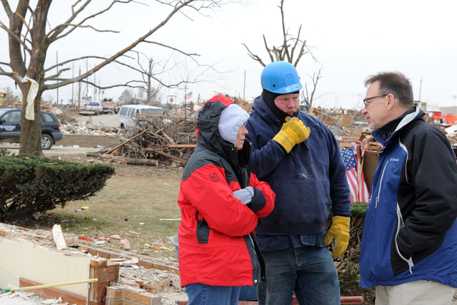 Washington, Ill., December 5, 2013 -- Rev. David Myers, right, Senior Advisor to the FEMA Administrator/Director Center of Faith-based & Neighborhood Partnerships, speaks with NECHAMA Jewish Response to Disaster operations manager Dan Hoeft, center and All Hands Volunteers director of US Disaster Response Sherry Buresh in a neighborhood where the two are helping with volunteer support for cleanup..  Myers met with Voluntary Organizations Active in Disaster groups to discuss responses to the disaster and discuss coordination and collaboration of partners. Jocelyn Augustino/FEMA