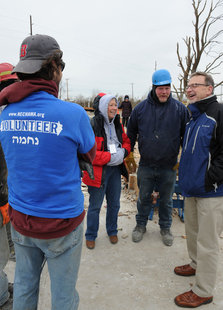 Washington, Ill., December 5, 2013 -- Rev. David Myers, right, Senior Advisor to the FEMA Administrator/Director Center of Faith-based & Neighborhood Partnerships, speaks with NECHAMA Jewish Response to Disaster volunteers as well as operations manager Dan Hoeft, center and All Hands Volunteers director of US Disaster Response Sherry Buresh in a neighborhood where the two are helping with volunteer support for cleanup..  Myers met with Voluntary Organizations Active in Disaster groups to discuss responses to the disaster and discuss coordination and collaboration of partners. Jocelyn Augustino/FEMA