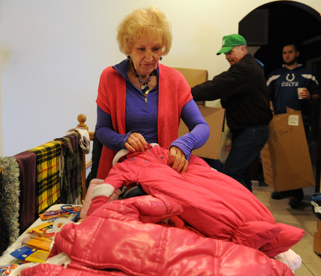 Washington, Ill., December 8, 2013 -- Volunteer JoAnn Willett, of Churches of Christ Disaster Relief Effort, prepares donated items for residents impacted by the recent tornado.  The distribution center has received donations for residents impacted by the tornado.  Jocelyn Augustino/FEMA