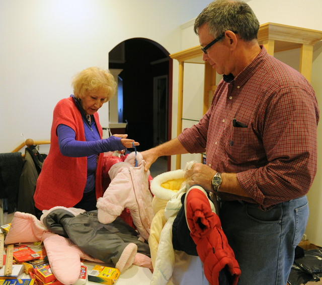 Washington, Ill., December 8, 2013 -- Volunteers Bryan Reeves, right, and JoAnn Willett, of Churches of Christ Disaster Relief Effort, prepares donated items for residents impacted by the recent tornado.  The distribution center has received donations for residents impacted by the tornado.  Jocelyn Augustino/FEMA