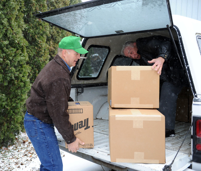 Washington, Ill., December 8, 2013 -- Volunteers Richard Hill, left, and Paul Willett, of Churches of Christ Disaster Relief Effort, unload donated items for distribution.  The distribution center has received donations for residents impacted by the tornado.  Residents impacted by the tornado are encouraged to register with FEMA by calling (800)-621-3362 or (TTY) (800) 462-7585 or online at www.DisasterAssistance.gov.  Jocelyn Augustino/FEMA
