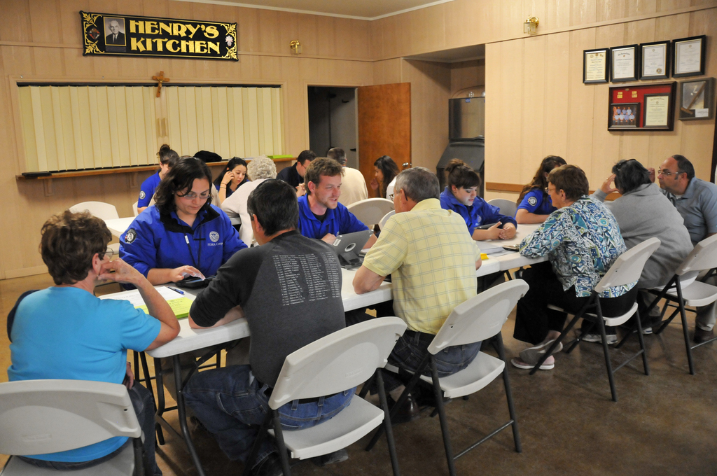 West, Texas, May 5, 2013 -- Local residents get help registering for disaster assistance during a town hall meeting held at the Knights of Columbus hall. FEMA Corps and Federal Emergency Management Agency workers were on hand for on-the-spot registration. FEMA is helping the community recover from the explosion and fire April 17. Norman Lenburg/FEMA