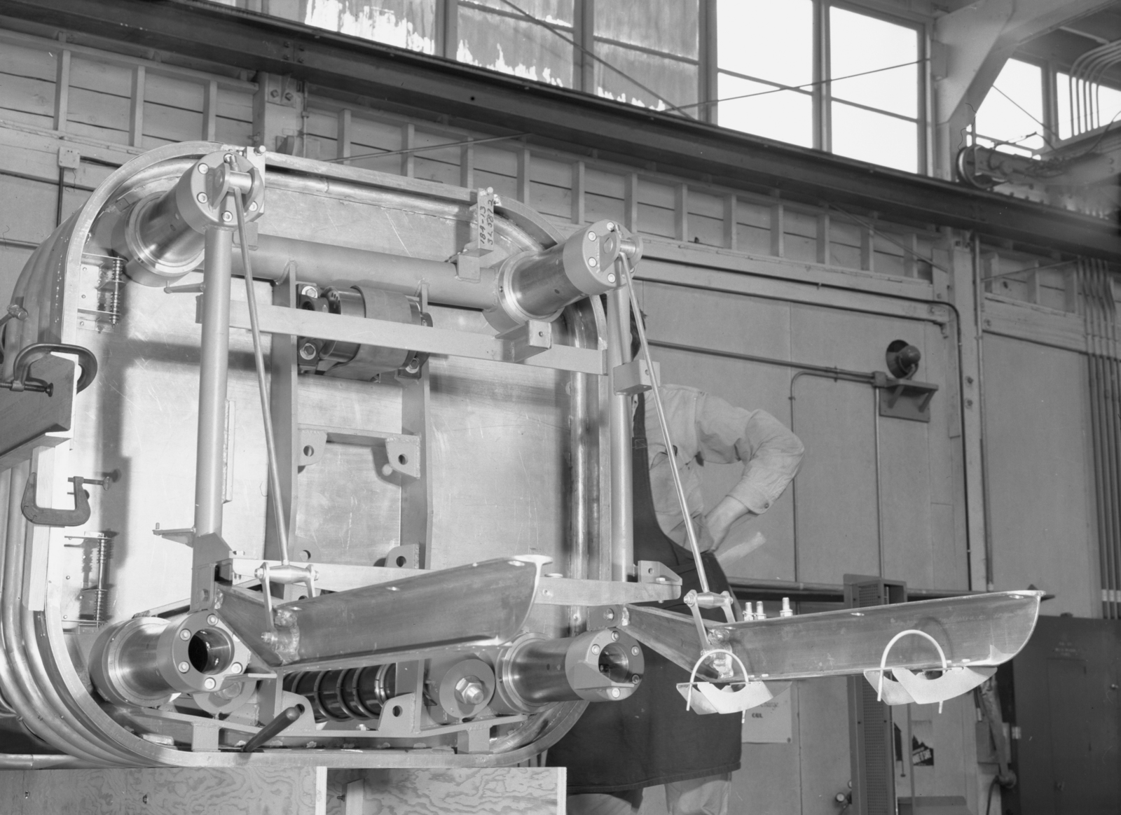 1/4 scale bevatron operating model. Chassis support assembly for injector ion gun. Associated individual: William Brobeck. December 16, 1948. Bevatron Model-96. Model briefly referred to as the Cyclodrome