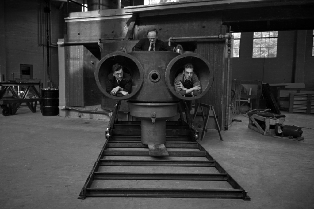 60-inch cyclotron (tank out), R. Thornton (above) with L.J. Laslett and J. Backus inside chamber tanks. Cooksey 793, Morgue 1944-65 (P-1) [Photographer: Donald Cooksey]