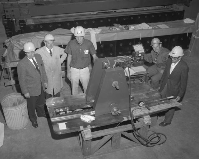 89-degree stanchion. Herman Grunder (second from left), Bob Everett, Jack Gunn, and Abe Glicksman. Photograph taken September 10, 1962. Bevatron-2933 – Photographer: George Kagawa