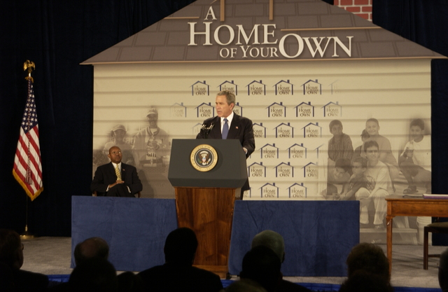 American Dream Downpayment Act signing ceremony at HUD headquarters,  with President George W. Bush  [joined by dignitaries including HUD Acting Secretary Alphonso Jackson and former Secretary Mel Martinez.  Administered under HUD's HOME Investment Partnerships program,  the Act will provide a maximum downpayment assistance grant of either $10,000 or 6% of the purchase price of the home, whichever is greater, for low-income, first-time homebuyers.]