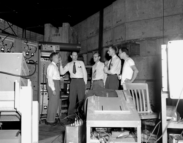 Antiproton experiment at the time of the discovery of the antiproton. From left to right: Dr. Emilio Segre, Dr. Clyde Wiegand, Dr. Edward Lofgren, Dr. Owen Chamberlain and Tom Ypsilantis, then a graduate student. Drs. Chamberlain and Segre were awarded th
