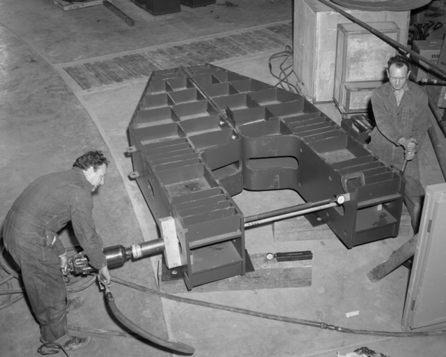 Bevatron coil end-winding support structure upper coil box. Support beam overload and testing. Photograph taken April 8, 1957. Bevatron-1290