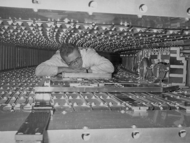 Bevatron lower pole tip with Bob Edwards. Photograph taken November 9, 1966. Bevatron-4126 – Photographer: George Kagawa