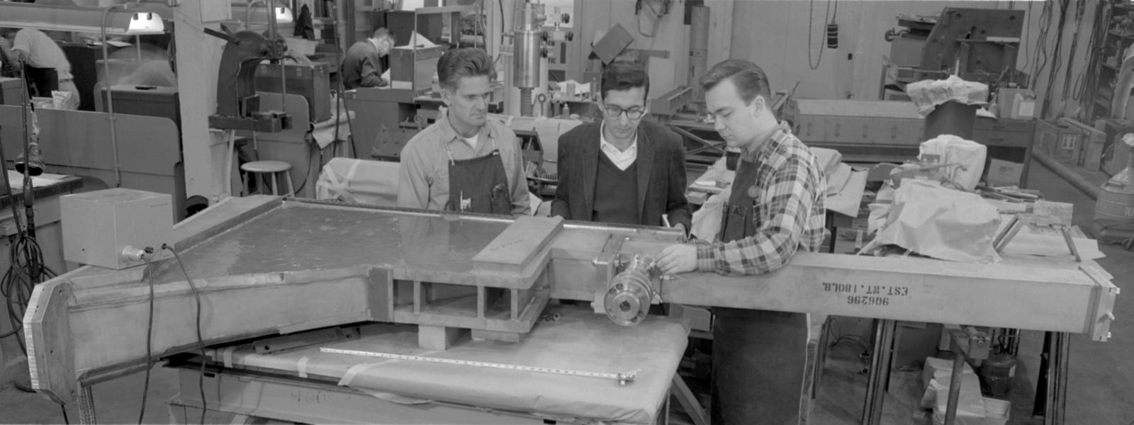 Bevatron vacuum checking extension tank, quadrant II, 89-degree area, includes Abe Glicksman, center, and Otto Draeger, right. Photograph taken December 5, 1962. Bevatron-3149 – Photographer: Doug Bradley