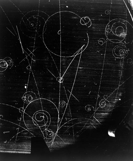 Bubble Chamber Event, formula demonstration. K-negative + P yields sigma-negative + pi-positive, L, pi-positive + h. Photograph taken May 8, 1956. Bubble Chamber-79