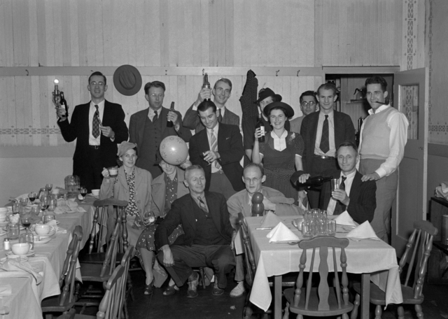 Celebration at DiBiasi's restaurant in Albany, CA. Back row (left to right, standing): Bob Cornog, Ernest Lawrence, Luis Alvarez, Molly Lawrence, Emilio Segre; second row (seated): Jerry Alvarez, Betty Thornton, (standing) Paul Aebersold, Iva Dee Hiatt, Edwin McMillan, Bill Farley; first row: Donald Cooksey, Robert Thornton and Bob Sihlis (celebrant). Cooksey 54 [Photographer: Donald Cooksey]