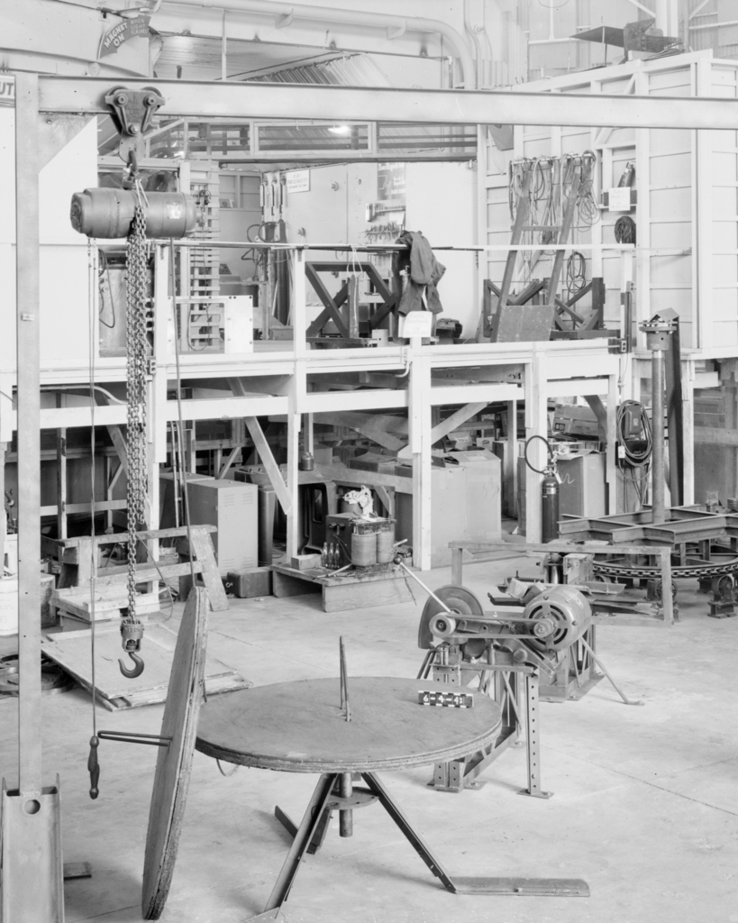 Coil winding mechanism, 184-inch cyclotron. Associated with Wilson Marcy Powell, Professor of Physics, UC Berkeley, Lawrence Berkeley Laboratory, Lawrence Livermore Laboratory, and Oak Ridge National Laboratory; Guggenheim Fellowship, Manhattan Project, 184-inch cyclotron, head of magnet group. Formerly confidential. Photograph taken June 4, 1943. Magnet-55