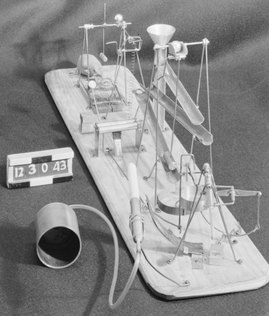 Combination cigarette lighter and atom smasher. Photograph taken December 30, 1943