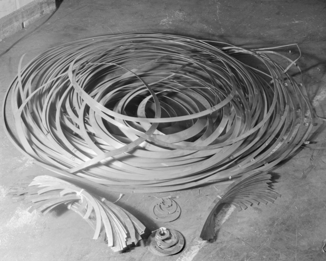 Copper collector rings of the ionic centrifuge, in storage at 2063 Addison Street, Berkeley. Photograph taken November 27, 1945