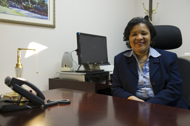 Desk shot of Vicky Lewis, Assistant Executive Secretary, Executive Secretariat