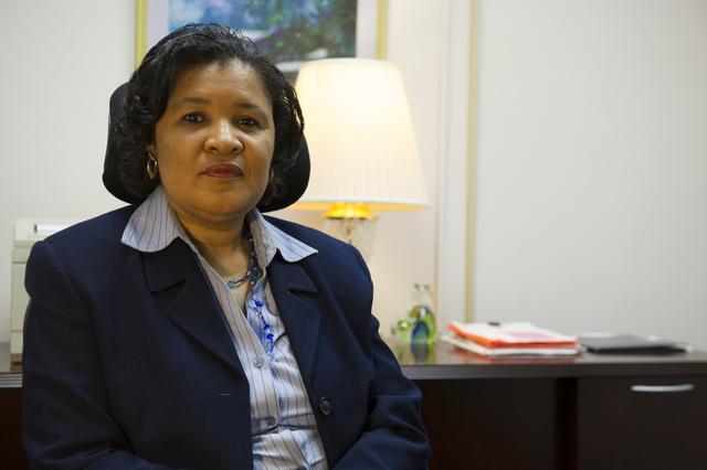 Desk shot of Vicky Lewis, Assistant Executive Secretary, Executive Secretariat