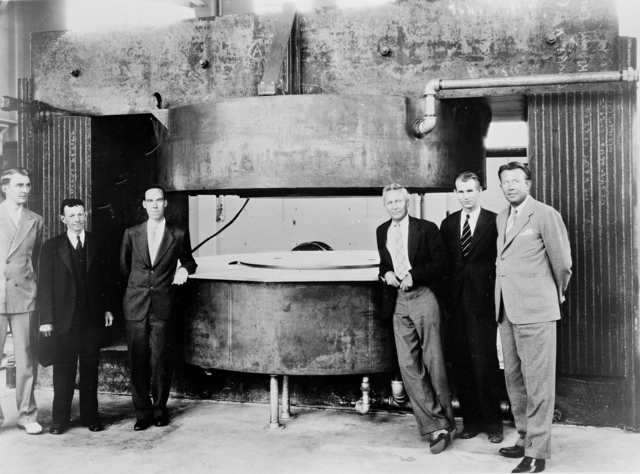 Early stages of the 60-inch cyclotron. Left to right: Dr. Luis Alvarez, William Brobeck, Dr. Donald Cooksey, Dr. Edwin McMillan, and Professor Ernest Orlando Lawrence. Morgue 1944-67 (P-1) [Photographer: Donald Cooksey]