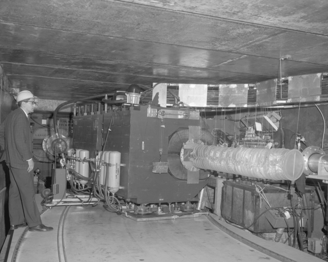 Ed Lofgren EPB experiment, winter 1964, with Abe Glicksman, left. Photograph taken April 14, 1965. Bevatron-3774 – Photographer: Doug Bradley