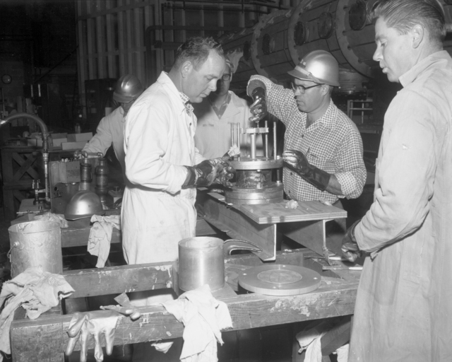 Epoxy seal mix and application on cooling tubes, Glenn White and Bob Richter. Photograph taken October 27, 1961. Bevatron-2486 – Photographer: George Kagawa