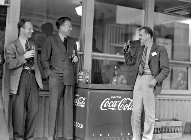 Ernest O. Lawrence and Edwin McMillan at the canteen by Coca Cola (Coke) machine outside of building 10. Morgue 1944-6 (P-1) [Photographer: Donald Cooksey]