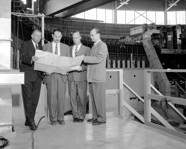 Ernest O. Lawrence, Edwin McMillan, William Brobeck, and Edward Lofgren looking at plans in bevatron. Photograph taken February 5, 1954. Bevatron-678. See also 434-LB-6-XBD201310-04019.TIF for similar
