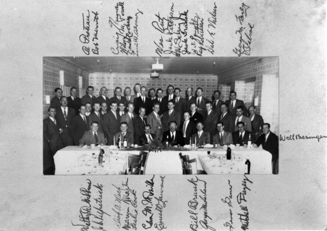 Ernest Orlando Lawrence (front row center) with Edwin McMillan to his right at synchrotron drive dinner at the Claremont Hotel. Group includes many significant individuals from the early Rad Lab days, some signatures included. Morgue 1944-92 (P-1) [Photographer: Donald Cooksey]