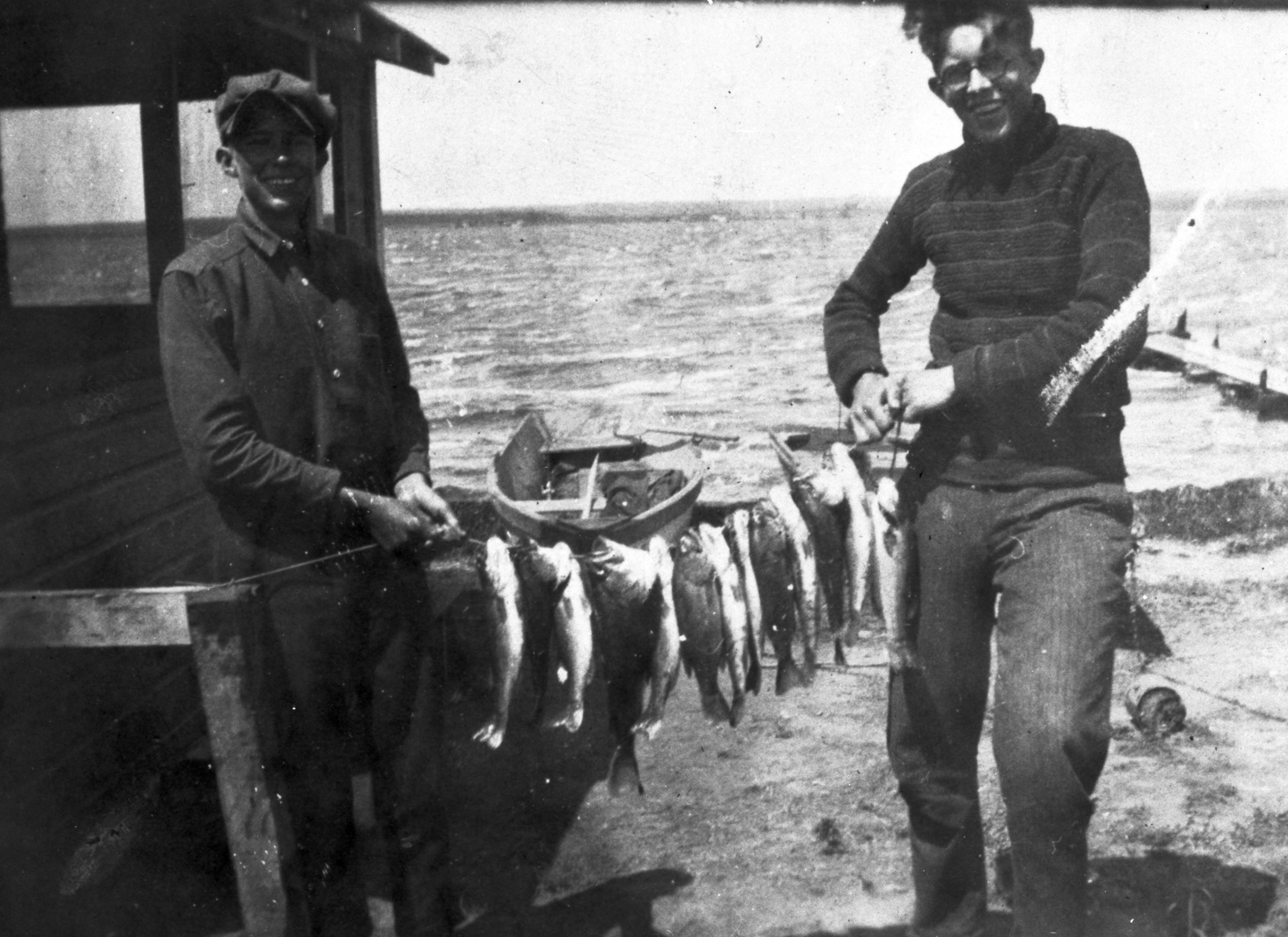 Ernest Orlando Lawrence (right) with friend and their catch of the day at Lake Andes, South Dakota, circa 1920. Digitized from damaged negative. Morgue 1958-8 (P-91) [Photographer: Donald Cooksey]