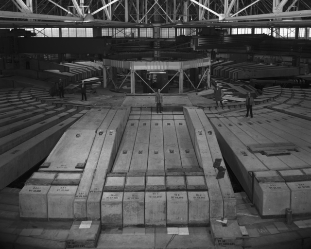 Five unnamed individuals (workmen) standing on Bevatron shielding blocks. Morgue 1963-3 (P-12) [Photographer: Donald Cooksey]