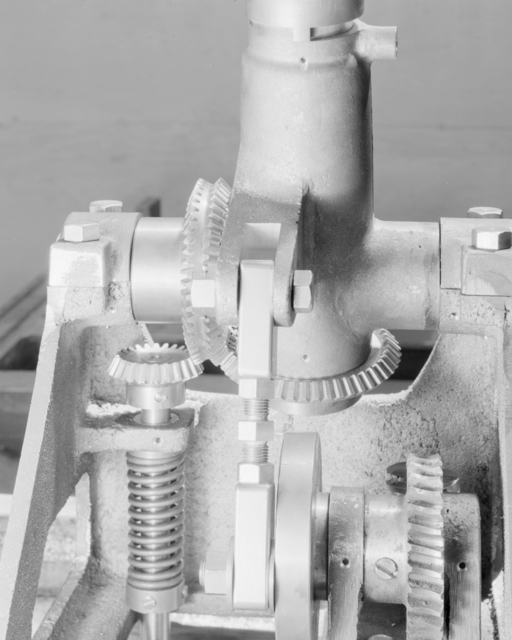 """Gears on tie-in survey device for alpha magnetic field measurement, referred to as """"Cedric."""" Formerly confidential. Photograph taken June 7, 1943. Magnet-73"""