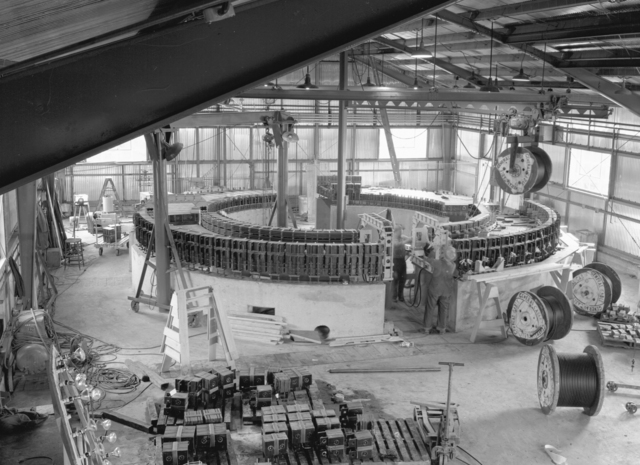 General interior view of 1/4 scale bevatron operating model showing progress on magnet. Associated individual: William Brobeck. December 11, 1948. Bevatron Model-89. Model briefly referred to as the Cyclodrome