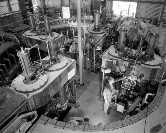 General view of 1/4 scale model bevatron (Beva/4) with Dr. Ed Lofgren (foreground) and Robert Richter. Photo taken October 20, 1949. Requested by Dan Wilkes. Bevatron Model-330. Briefly referred to as the Cyclodrome