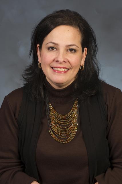 Head shot of Migdalia Murati, Single Family Program Advisor, Office of Housing