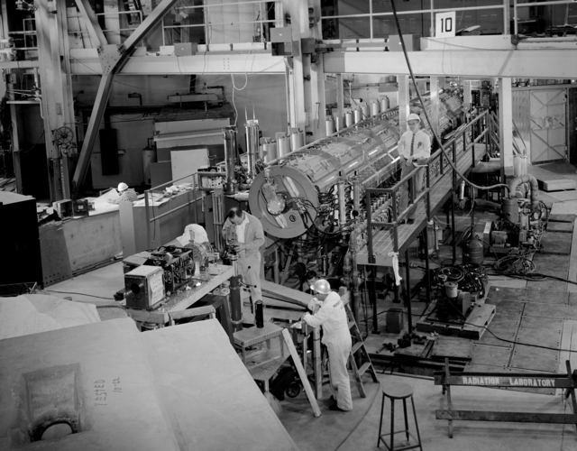 Heart of new injection system is the 19 Mev strong-focusing linear accelerator. The Linac II was built and tested in Building 64, then moved by truck to its permanent site at the Bevatron. Not visible in the picture is the 480 kv Cockcroft-Walton ion gun – Photographer: George Kagawa